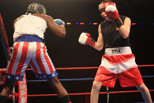 Lamin Kamara (left) and Edward Ortiz (right) box for the novice middlewight title at the San Antonio Regional Golden Gloves competition at the Scottish Right Center on February 25, 2012.