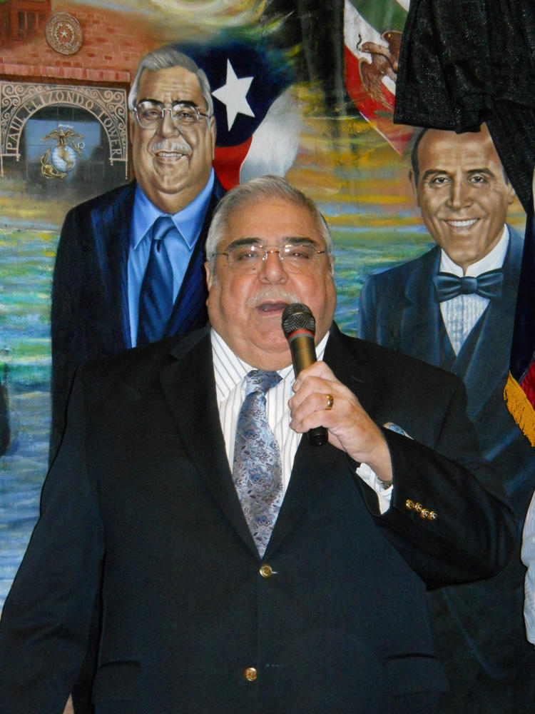 Bexar County Commissioner Paul Elizondo takes the microphone at the unveiling of his addition to the Mi Tierra mural.