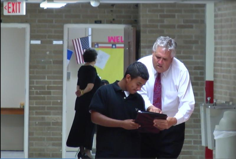 Premont ISD Interim Superintendent Ernest Singleton helps a student on the first day of the Fall 2011 semester. Singleton confirmed rumors and issued a challenge to students.