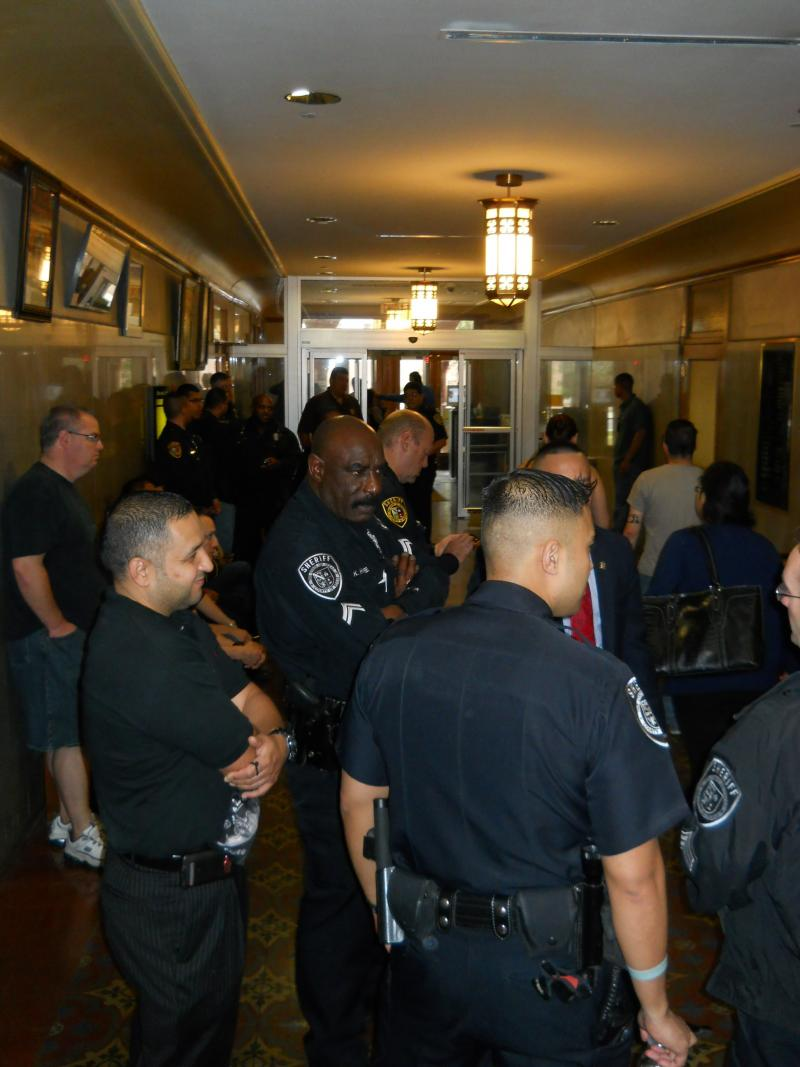 Bexar Co. deputies wait for sheriff to make presentation to county commissioners