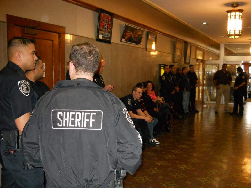 Deputies crowd into the hall at the Bexar Co. Courthouse in support of the sheriff's request for additional funding for overtime pay