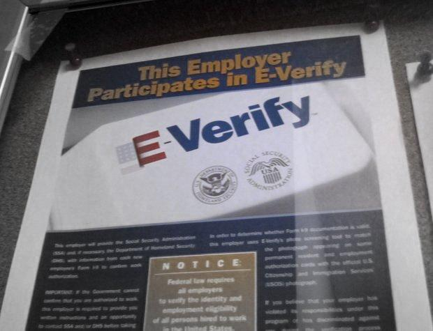 Employers that use E-Verify in the hiring process display a sign in their office.