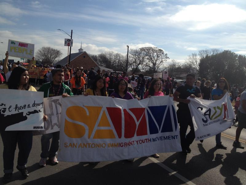 Members of the San Antonio Immigrant Youth Movement hold a banner as they march through the parade. The movement was generated to help young immigrants find resources for assistance