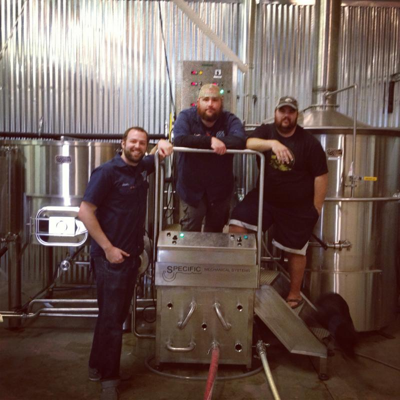 (From Left to Right) Jason Ard, head brewer Les Locke and employee JC Norris all pose inside the brewery where Branchline beer will be made.
