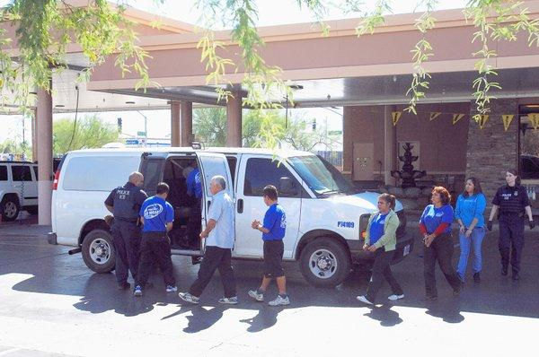 Undocumented immigrants are rounded up at a car wash in Maricopa Couty, Ariz.