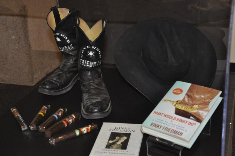 "Former Texas gubernatorial candidate Kinky Friedman's boots, cowboy hat and cigars on display that the UTSA Institute of Texan Cultures' ""Texans Head to Foot"" exhibit."