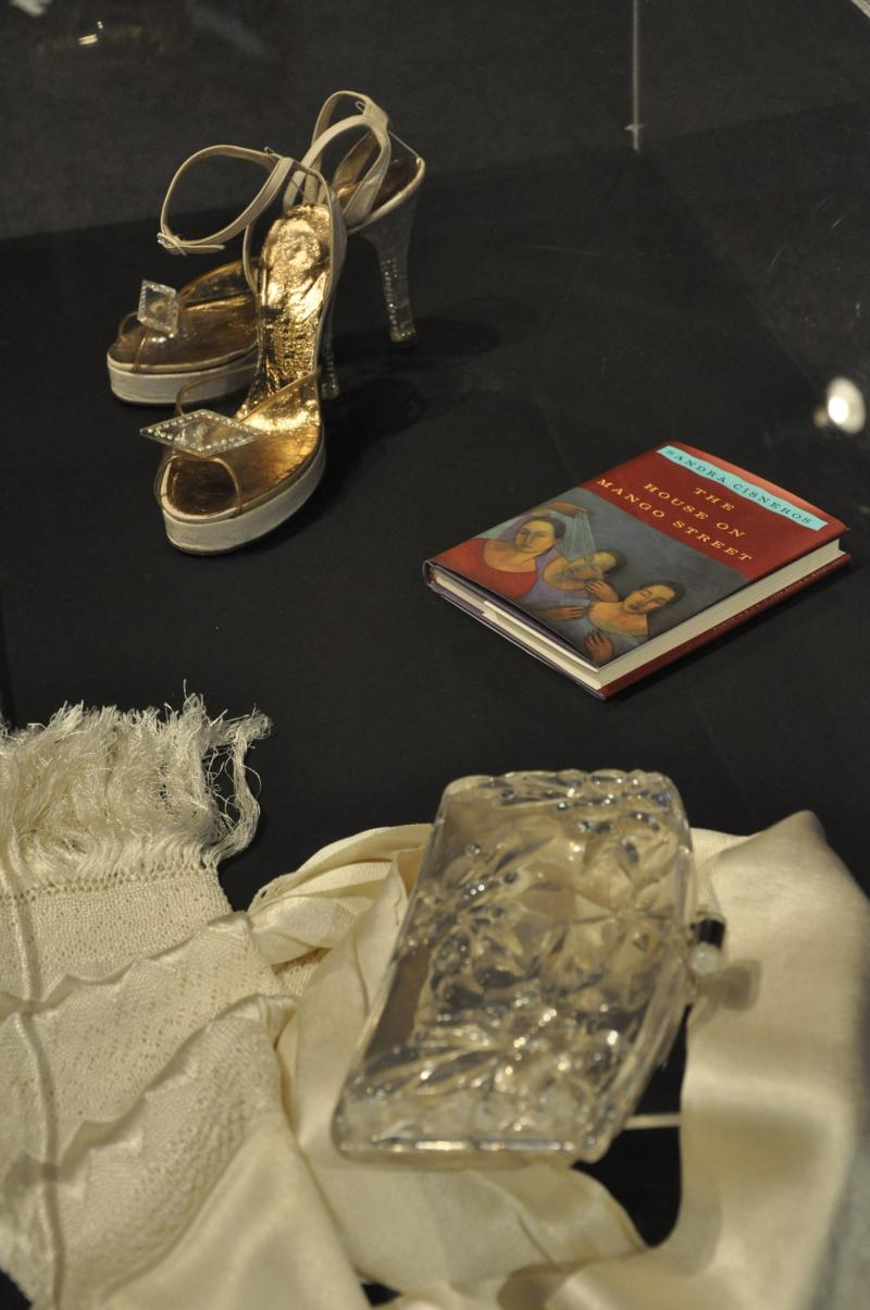 "San Antonio author Sandra Cisneros' heels, purse and shawl on display that the UTSA Institute of Texan Cultures' ""Texans Head to Foot"" exhibit."