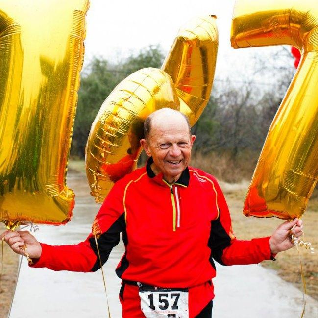 Larry Macon is the World Record Holder for most marathons run in a year. Seen here celebrating the record 157th marathon.