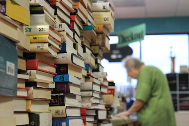 At Nine Lives Books, the buy back counter is stacked with books waiting to find homes on the shelf.