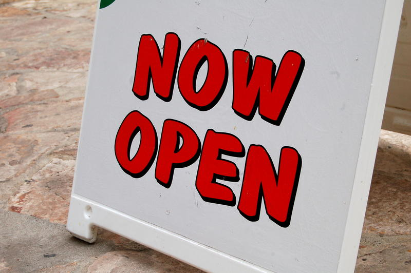 """Now Open"" sign outside a business in downtown San Antonio"