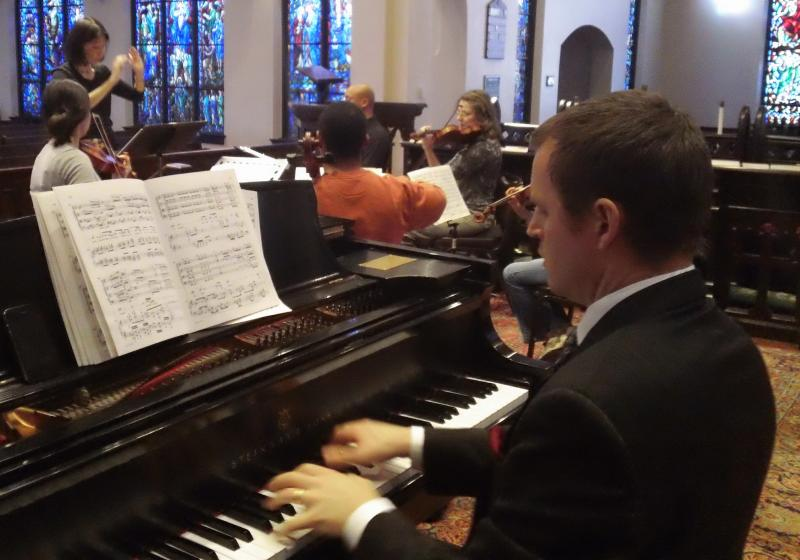Pianist Brent Watkins rehearses with Musical Offerings led by Akiko Fujimoto