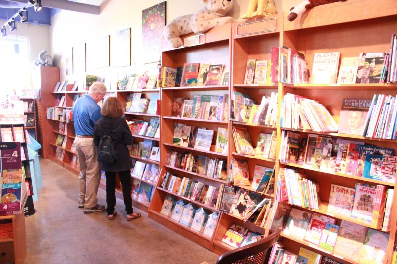 Diane and Jeff Freeman look at children's books for their granddaughter while visiting The Twig.