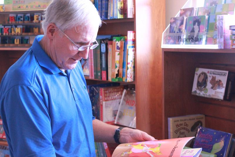 Jeff Freeman, who was visiting San Antonio from California with his wife, Diane, looks through the children's books at The Twig.