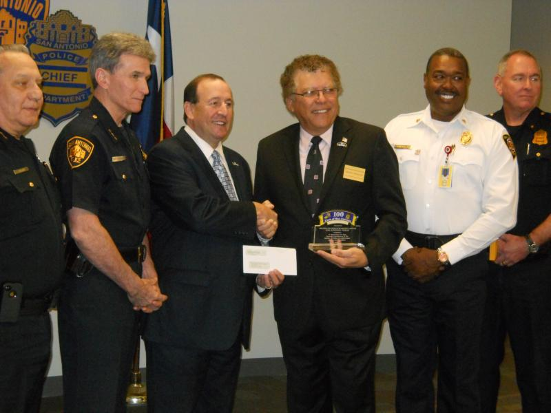 SAPD Chief William McManus (second from left) joins 100 Club President Richard Miller, Speedy Gonzalez of Red McCombs and San Antonio Fire Chief Charles Hood in accepting the donation