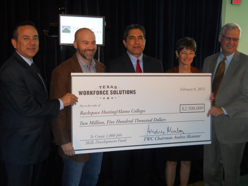 State Senator Carlos Uresti (left) stands with Rackspace CEO Lanham Napier, Texas Workforce Commission Chairman Andres Alcantar, State Sentator Donna Campbell, and Alamo Colleges Chancellor Bruce Leslie holding a bill check.