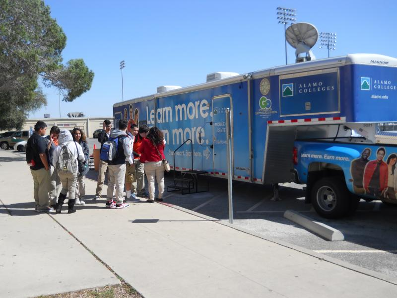 Burbank Students line up at The Alamo Colleges' Mobile Go Center to get help applying for financial aid and applying to college.