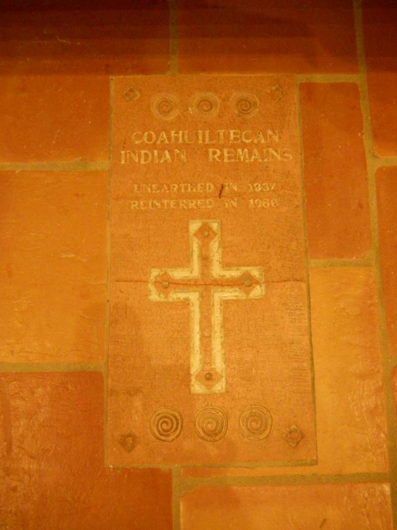 A floor tile near the altar depicts the reinterment of other human remains unearthed at the mission in the early 20th Century