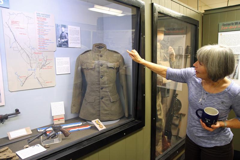 Fort Sam Houston Museum Director, Jacqueline Davis, explains howfield uniforms evolved into the Army Combat Uniform