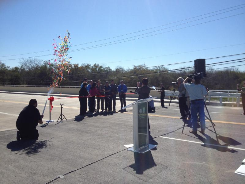Bexar County Commissioner Chico Rodriguez cuts the ribbon to re-open the S. Flores Bridge along Sixmile Creek