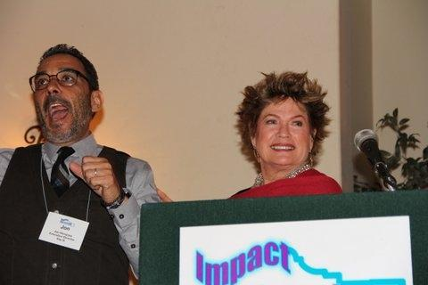 SAY SI Artistic Director, Jon Hinojosa, reacts to surprise $100,000 check from IMPACT President Ann Parker
