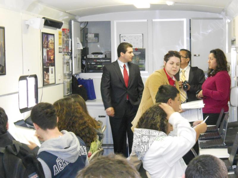 District 5 Councilman David Medina joins Burbank High School students on the Alamo Colleges' Mobile Go Center in late Feb.