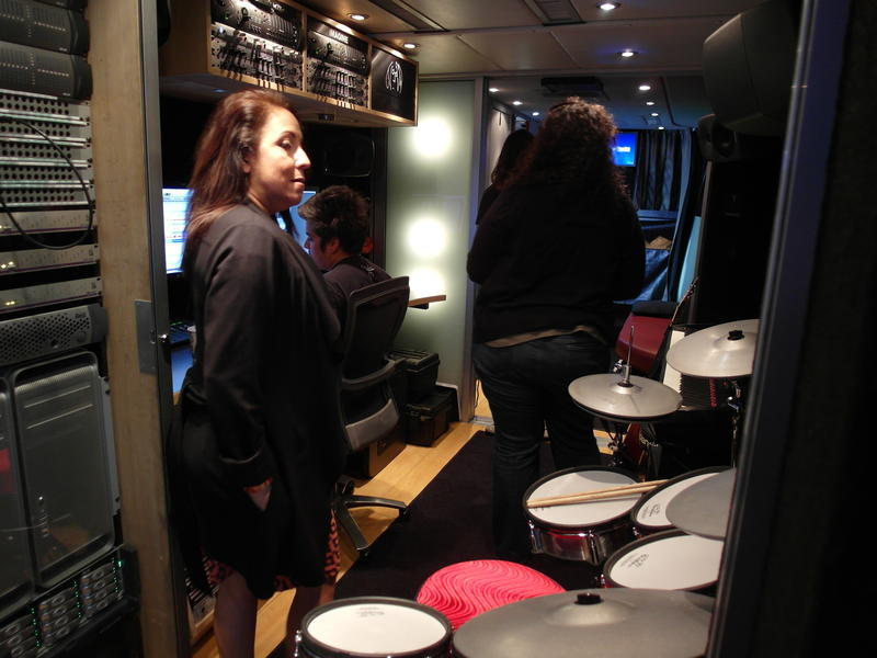 The staff of the John Lennon Bus offers basic music lessons, and helps kids record songs and videos.