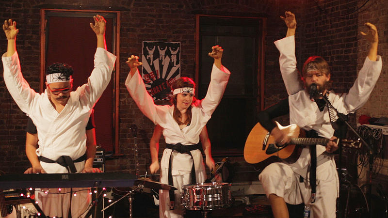 The Karate Kids (Francisco Barreiro, Ashley Rae Spillers and Geoff Marslett) play a house party in New York.
