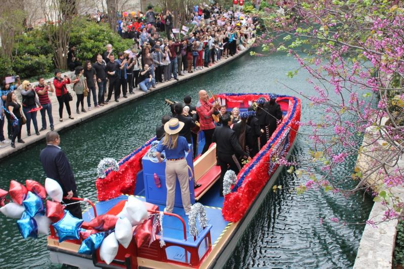 Crowds line the Riverwalk to see Howie Mandell on the first barge of America's Got Talent mini river parade, piloted by Elizabeth Taylor of Rio San Antonio Cruises