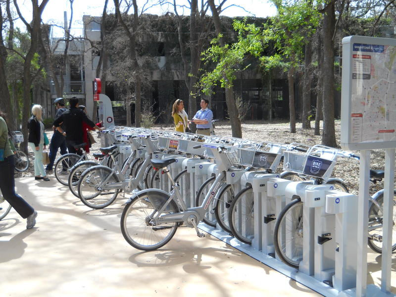 Patrons checkout B-Cycles at the Witte Museum during a special touring ride of the new stations.