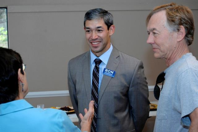 Ron Nirenberg speaks to people at the Hunters Creek meet and greet