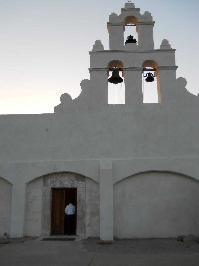 A parishioner enters San Juan Capistrano after its restoration completed in Feb. 2013