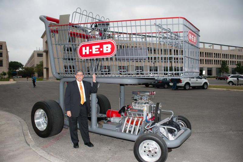 UTSA President Ricardo Romo next to a giant shopping cart with some horsepower.