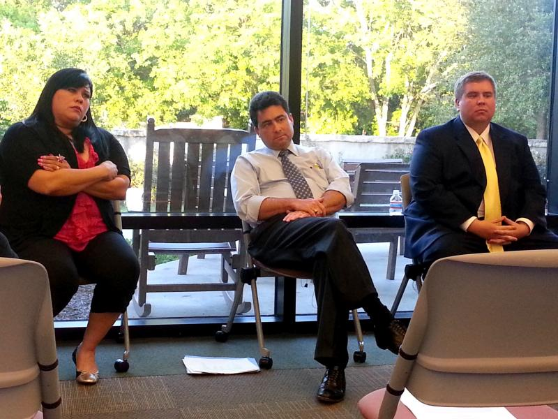 Dist. 10 council candidates listen to questions presented at a public forum at the Semmes Library April 11.