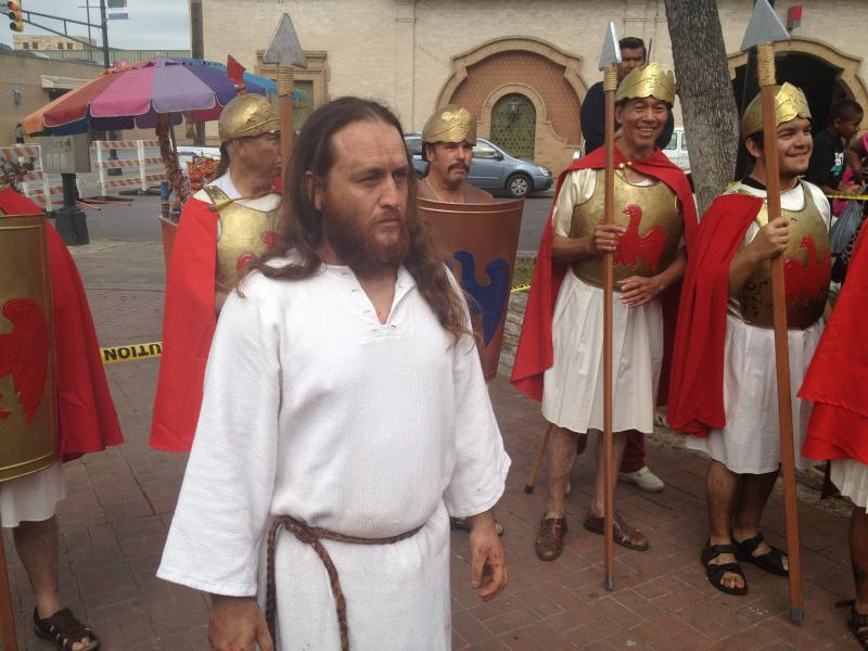 John Austin, portraying Jesus, stands 'backstage' as Mass is held before the Passion Re-enactment at Milam Park.