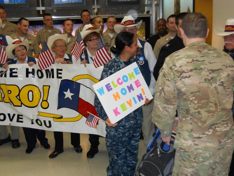 Sailors welcome Petty Officer 2nd Class Kevin Buehler from Afghanistan duty