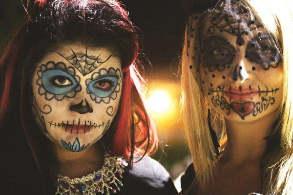 Valeria Pearson, left, and Jessica Perry took a couple of hours to pain their faces like sugar skulls for Dia de los Muertos. The celebration in Las Vegas takes place at the Winchester Cultural Center.