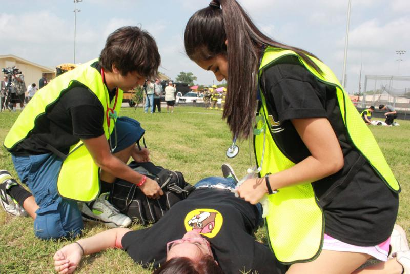 As the exercise begins, medical students rush to administer first aid to victims in the field.