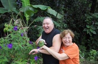 John and Blanca Dungan with their pet parrot. At first, they were very happy in Costa Rica.