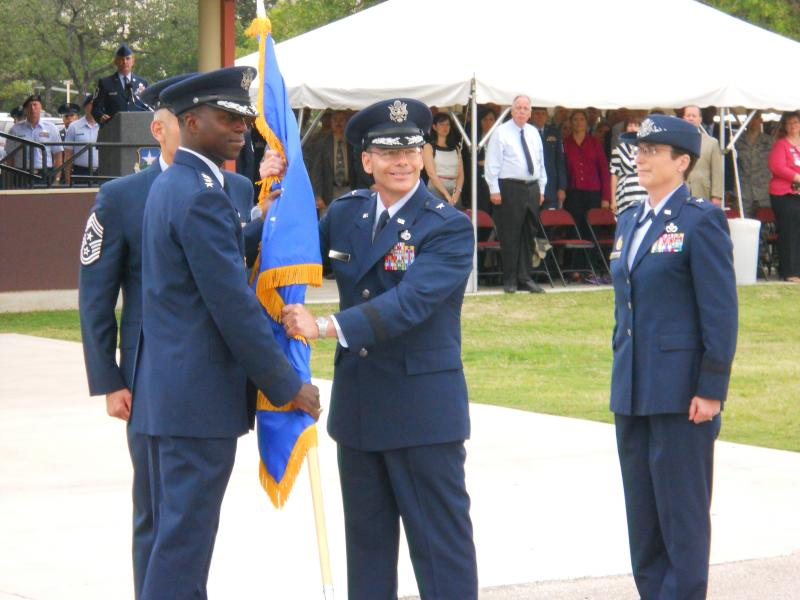 Brigadier General Robert La Brutta takes the wing command flag from Gen. Edward A. Rice, Jr.