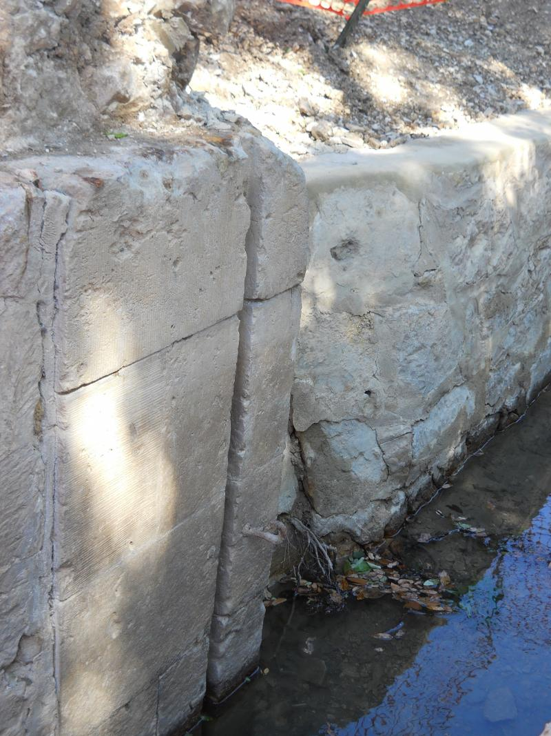 Depection of the German engineering on the Upper Labor Acequia. German masons in the mid-1800s added to the Spanish construction underneath, originally built in the 1700s