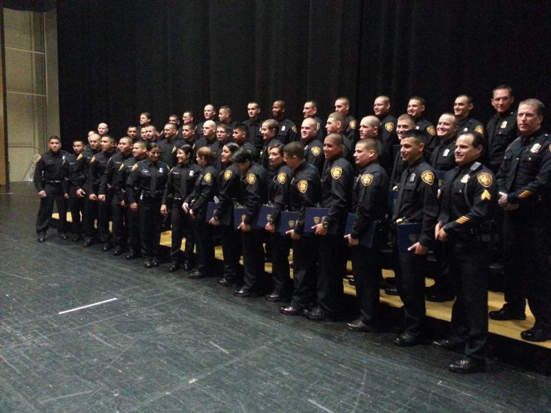 Police cadets of 2012-B pose for pictures following the graduation ceremony.