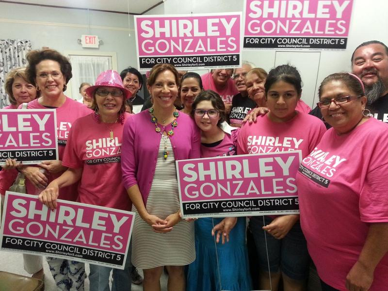 Newcomer Shirley Gonzlaes, a candidate for District 5, stands with supporters on election night.