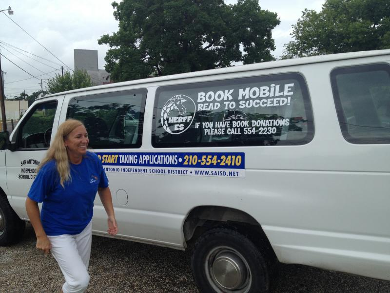 Principal Tracy Smith disembarks from the Book Mobile