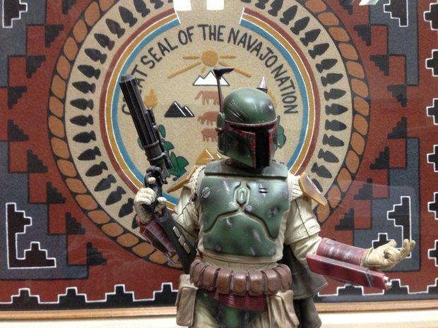 """Star Wars"" character Boba Fett in front of the Navajo Nation seal."