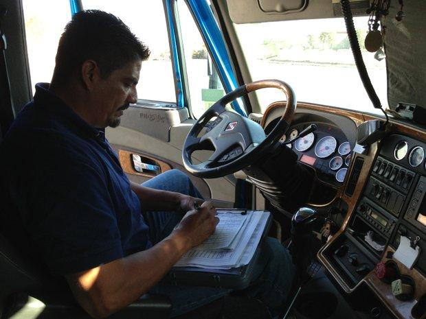 Trucker Alejandro Rivera fills out paperwork after delivering a load from a factory in Ciudad Juárez to a warehouse in El Paso.
