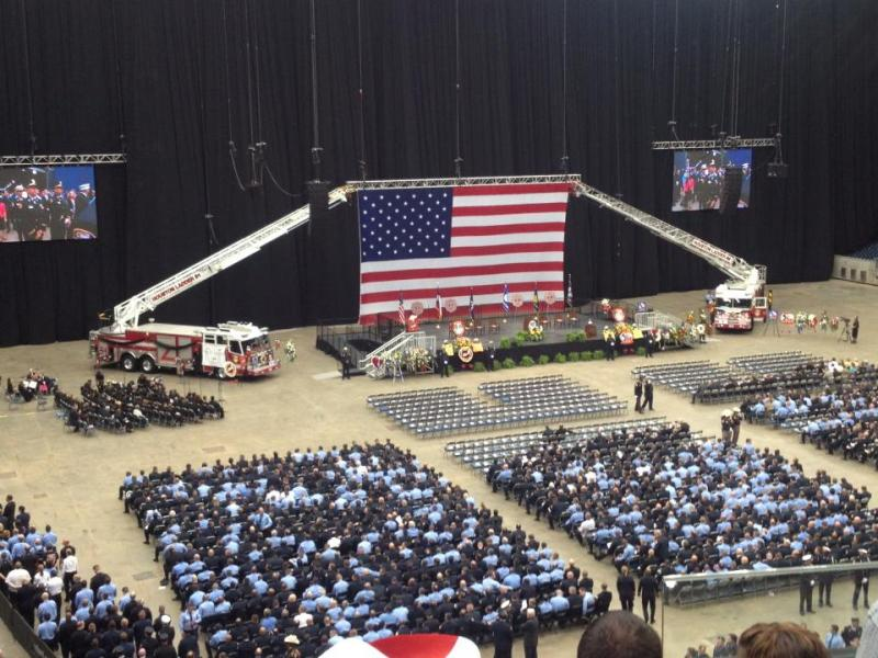 Inside Reliant Stadium at memorial for four Houston firefighteres killed Friday, May 31, 20132