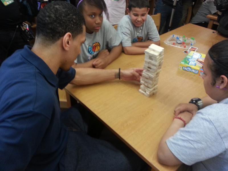 Danny Green plays games with kids at Wheatley Middle School after the ribbon was cut on the new NBA Cares learning center.