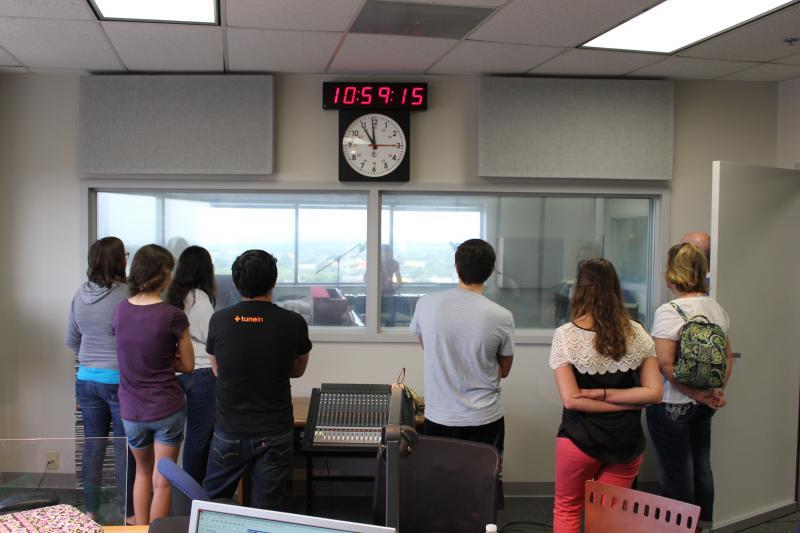 The students look on as their peers perform in Studio B40.
