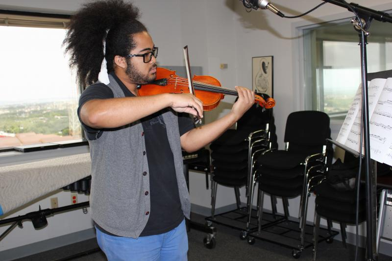 Darian Thomas performs his own solo violin compositions.