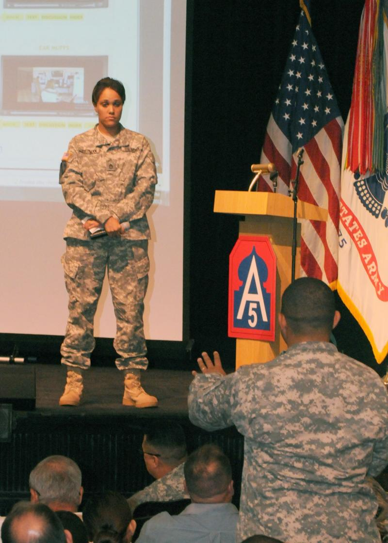 Sgt. 1st Class Carla Pittman, who works in the logistics section for Headquarters and Headquarters Battalion, U.S. Army North (Fifth Army), listens to a question from a fellow Army North Soldier.